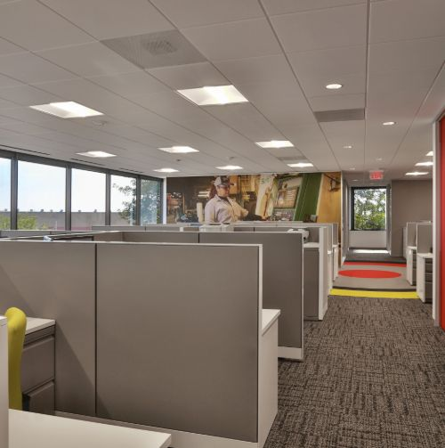 overview of office space with grey cubicles